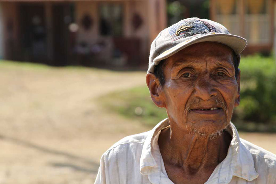 A man stands in the street near the center of Boruca. Most people get around the village on foot or horseback, reserving automobiles for longer trips to towns along the Pan-American Highway.