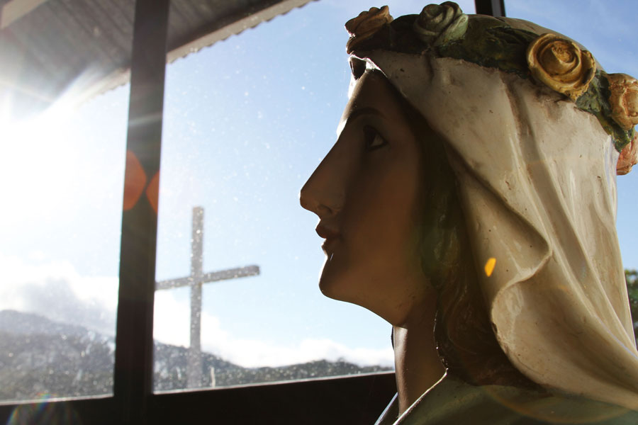 An important figure in the Roman Catholic Church, a statue of the Virgin Mary stands inside the church in Boruca. Church bells ring out across the village to alert the people that it is time for Mass.