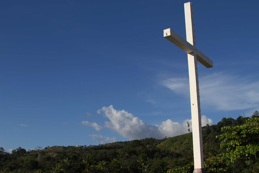 A large cross towers above Boruca near the church. Ladder steps on the cross allow for the nightly lighting of the cross points. The huge cross towers above Boruca as a reminder of the Spanish effort to convert the indigenous community.