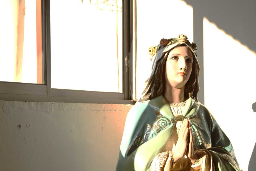 A statue of the Virgin Mary stands inside the church in Boruca. Most people of the village consider themselves Catholic, but also hold other spiritual beliefs passed down by village elders.