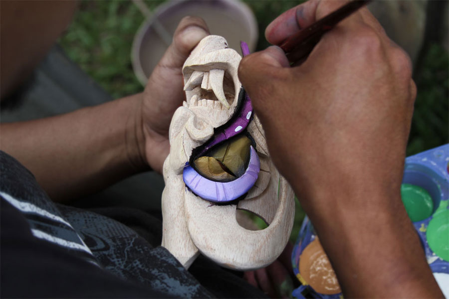 After the balsa wood is carved, a Boruca man begins the painting process. Each mask contains unique colors, designs and paints.