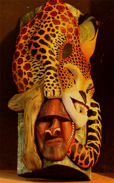 An ecological Boruca mask is displayed in the museum, featuring the designs of a leopard, a tropical bird and an indigenous man. Ecological masks feature nature imagery.